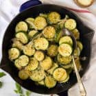 Easy Sauteed Zucchini with Onions and Parmesan. Golden, delicious zucchini and squash, cooked with butter, garlic, and your favorite seasonings. Healthy and simple, it's the perfect summer side dish!