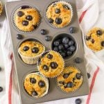 Gluten free muffins wtith blueberries in a muffin pan