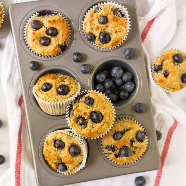 Fluffy and moist Gluten Free Muffins with blueberries! This easy gluten free muffin recipe is made with almond flour and contains NO SUGAR! Naturally sweetened with banana and pure maple syrup.