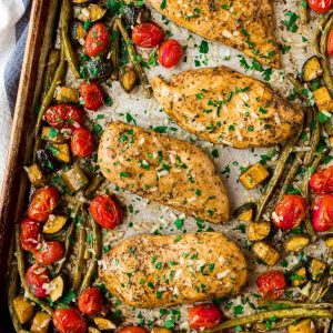 Baked Italian Chicken with Vegetables. Flavor-packed chicken breasts with tomatoes, zucchini, and any other fresh vegetables you love. Everything cooks on ONE PAN in the oven for an easy, healthy dinner! Great for meal prep and the the balsamic Italian chicken marinade is to die for.