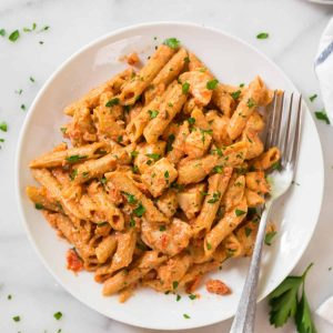 """Healthy Penne Alla Vodka with Chicken. BEST RECIPE! A lighter version of classic vodka sauce made with tomatoes and almond """"cream."""" Dairy free and delicious!"""