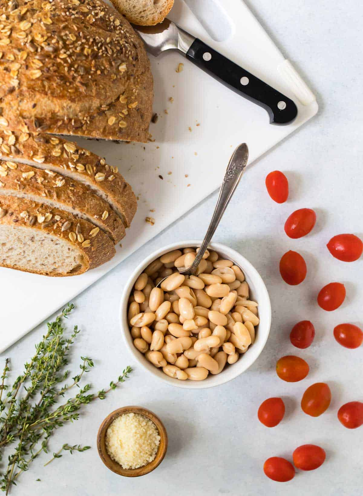 Cannellini beans served on toast with tomato and garlic