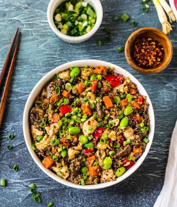Healthy Quinoa Fried Rice with Chicken, Vegetables, and Egg. Easy, delicious, and packed with protein! Perfect for 21 day fix, Paleo, and gluten free diets. This is a family favorite and great for using up any leftover veggies. Even better than take out!