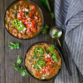 The BEST Crock Pot Pinto Beans! Easy, healthy recipe that tastes even better than a restaurant. No soaking required! Use this healthy slow cooker pinto beans recipe anytime you need canned beans, or mash it to make slow cooker refried beans.