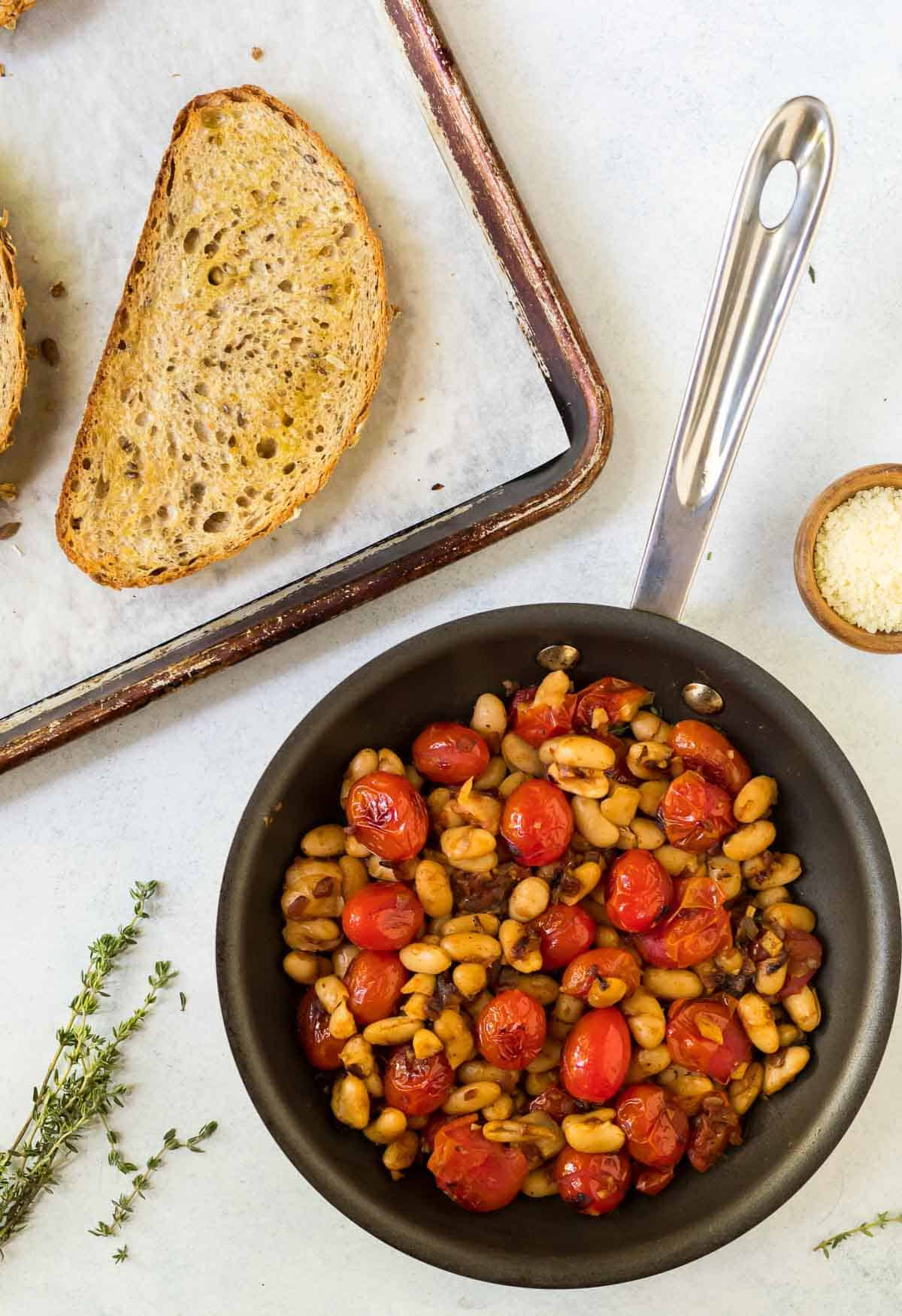 Tuscan white beans with sauteed cherry tomatoes served on toasted bread.