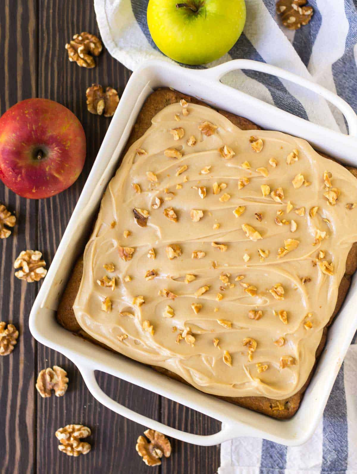 Moist, spiced apple cake with caramel cream cheese frosting and walnuts.