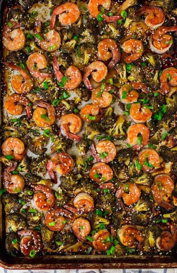 Healthy Sheet Pan Shrimp and Broccoli. Easy and DELICIOUS! Tastes like your favorite Chinese stir fry shrimp and broccoli but is so much better for you. Cooks on ONE PAN and the Chinese brown sauce is incredible. Serve with rice or quinoa for fast and healthy weeknight dinner.
