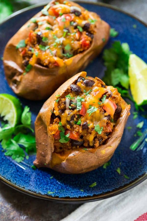 Easy Stuffed Sweet Potatoes are loaded with cheese, black beans, and quinoa.