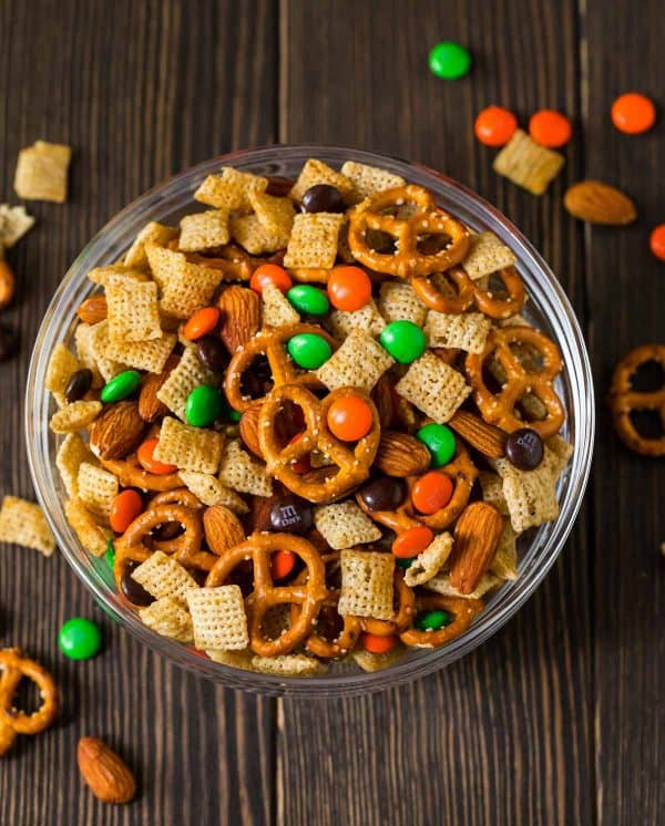 Chocolate Orange Party Mix. Sweet, salty, and perfect for Halloween! You can use halloween colored chocolates or swap out the colors for Christmas or your team's colors for game day.