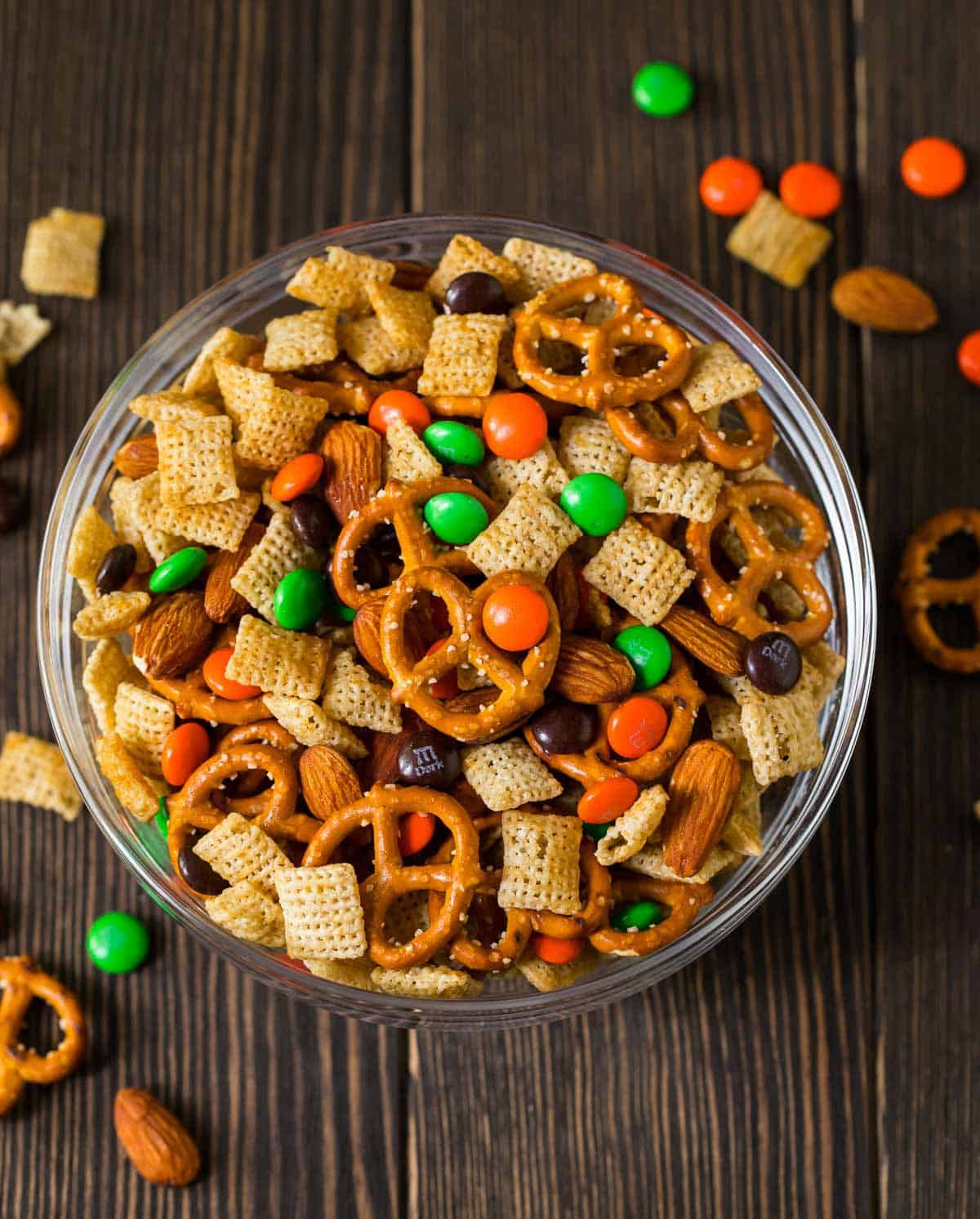 Chocolate Orange Party Mix. Sweet, salty, and perfect for Halloween! You can use halloween colored chocolates or swap out the colors for Christmas or your team's colors for game day. #chexmix #partymix #wellplatedrecipes
