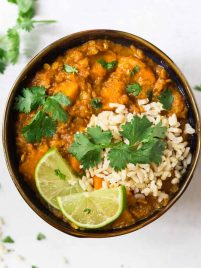 Red lentil curry with rice in a bowl