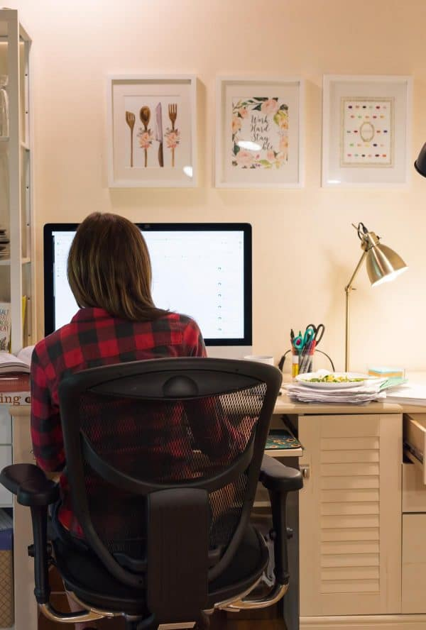 Erin Clarke working at a desk on her cookbook