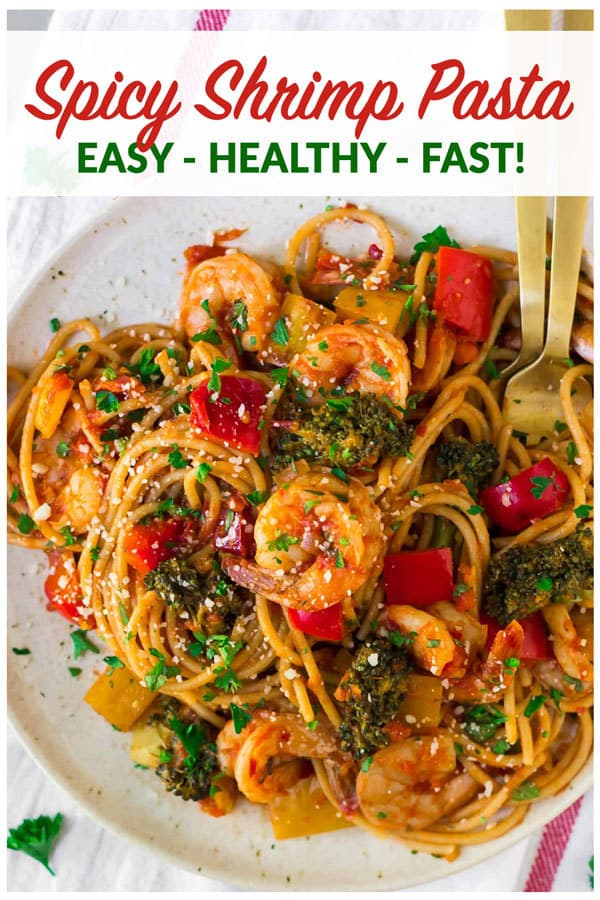 Spicy Shrimp Pasta. A fast, flavorful, healthy shrimp recipe! With garlic, lots of veggies, whole wheat spaghetti, and an easy tomato sauce, this is one of our go-to weeknight main dishes. #wellplated #pasta #shrimp #dinner #healthy