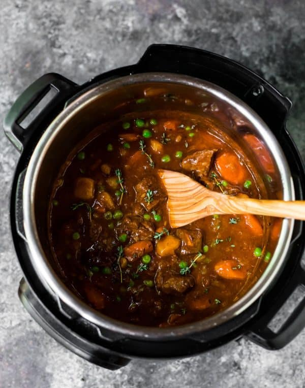Instant Pot Beef Stew. Full of tender beef, potatoes, carrots, and peas.