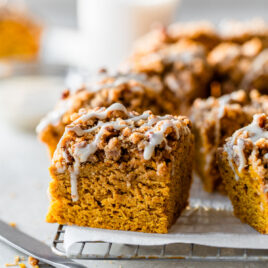 A slice of moist Pumpkin Coffee Cake with Streusel Topping and Maple Glaze