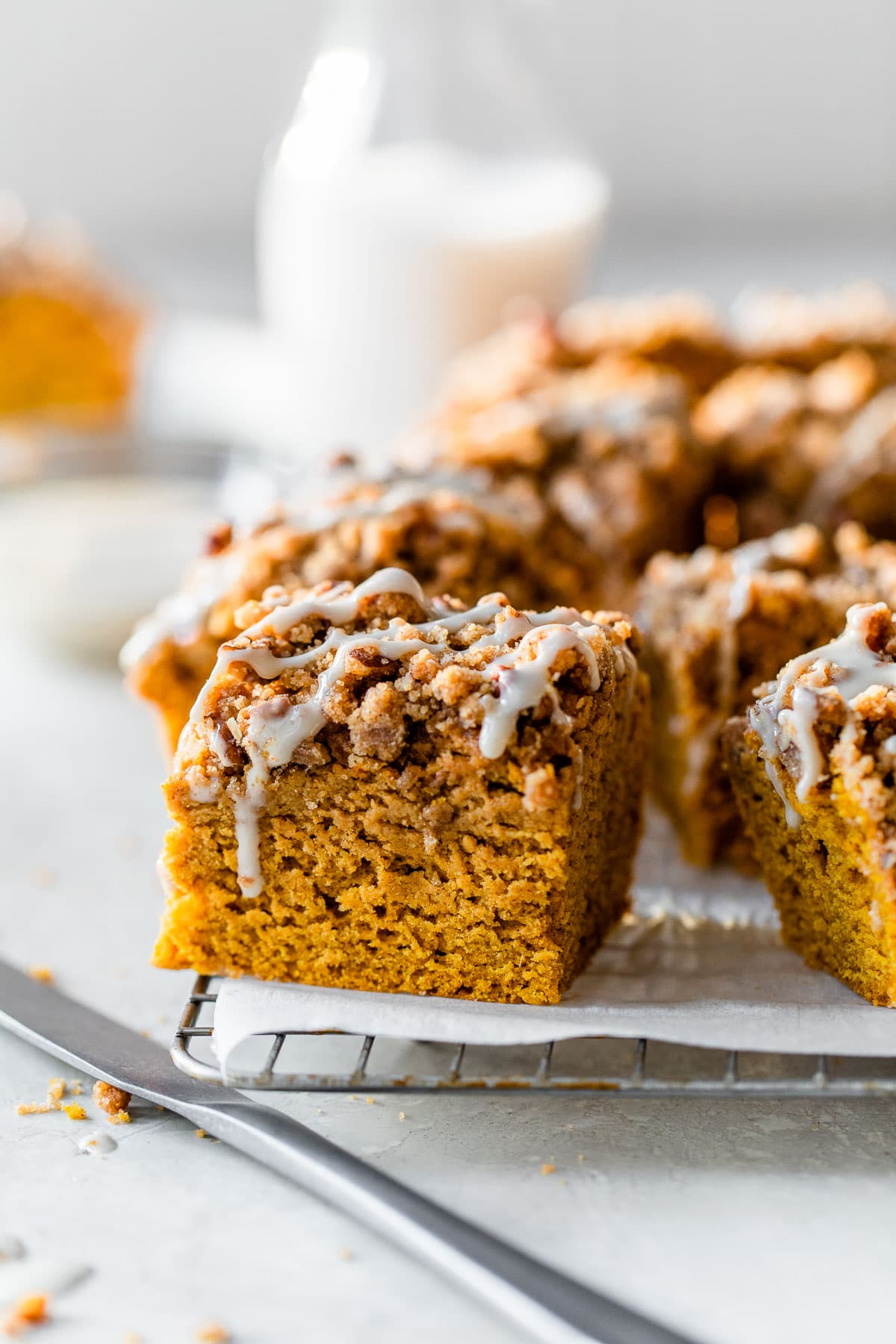A pumpkin coffee cake in a baking dish and served on two plates