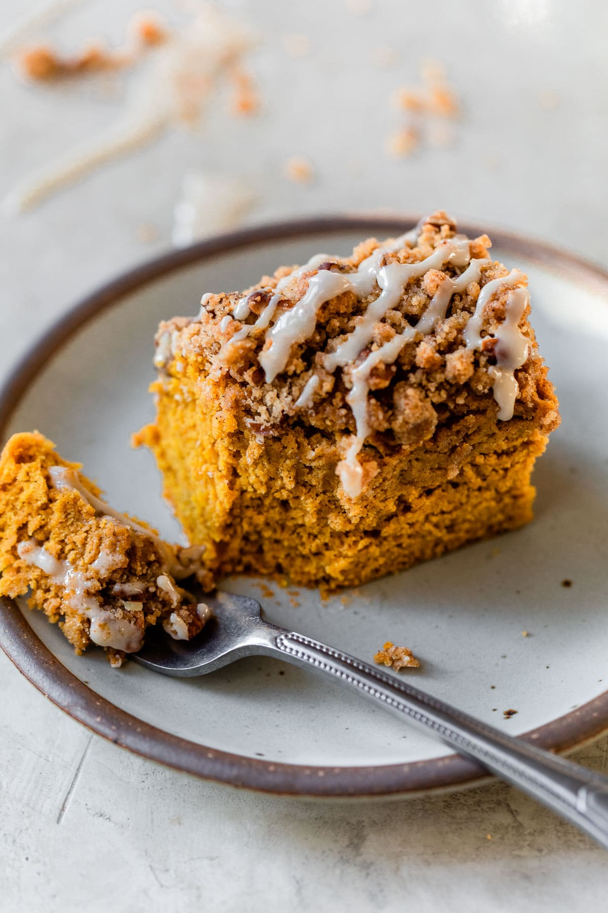 Easy Pumpkin Maple Coffee Cake. Topped with streusel and maple glaze!
