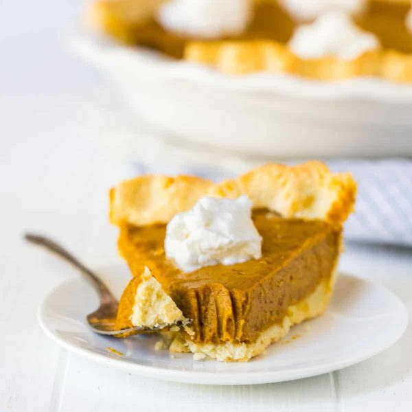 Vegan Pumpkin Pie with almond flour pie crust. EASY, delicious no bake filling made from dates, almond butter, pumpkin, and warm spices. Naturally sweetened (no sugar!), gluten free, grain free, and dairy free.
