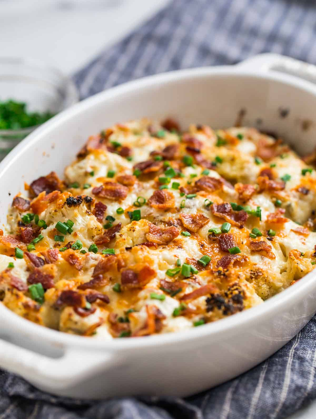 Christmas or Thanksgiving cauliflower casserole in a baking dish with bacon and chives