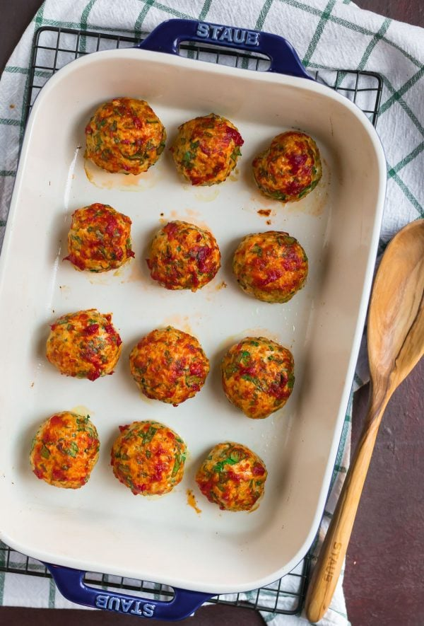 Baked Chicken Meatballs with Italian spices. Serve with pasta, zoodles, or as meatball subs!