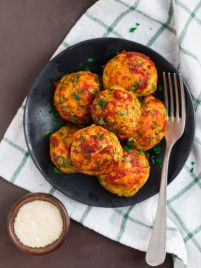 Baked chicken meatballs on a black plate