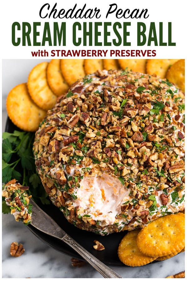 A sweet and savory Cream Cheese Ball with Cheddar, Strawberry Preserves, and Pecans. This easy twist on a classic cheese ball recipe is the BEST cheese ball you'll ever taste! A perfect appetizer for Thanksgiving, Christmas, and football games. #wellplatedrecipes #cheeseball #creamcheeseball #appetizer
