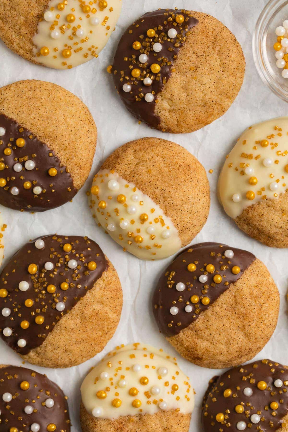 Soft, chewy rum snickerdoodles dipped with chocolate