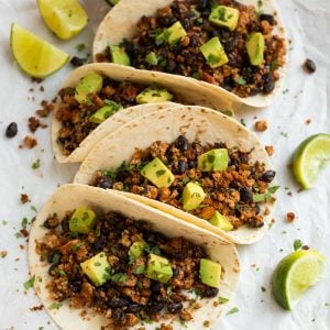 Quick and easy Tofu Tacos with black beans. Crispy, lightly spicy, and delicious! A high protein vegetarian meal that's ready in less than 30 minutes.