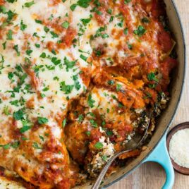 An easy, healthy skillet lasagna with Italian sausage, butternut squash, ricotta, and spinach. Everything cooks in ONE pot (cast iron or regular) for easy clean up!