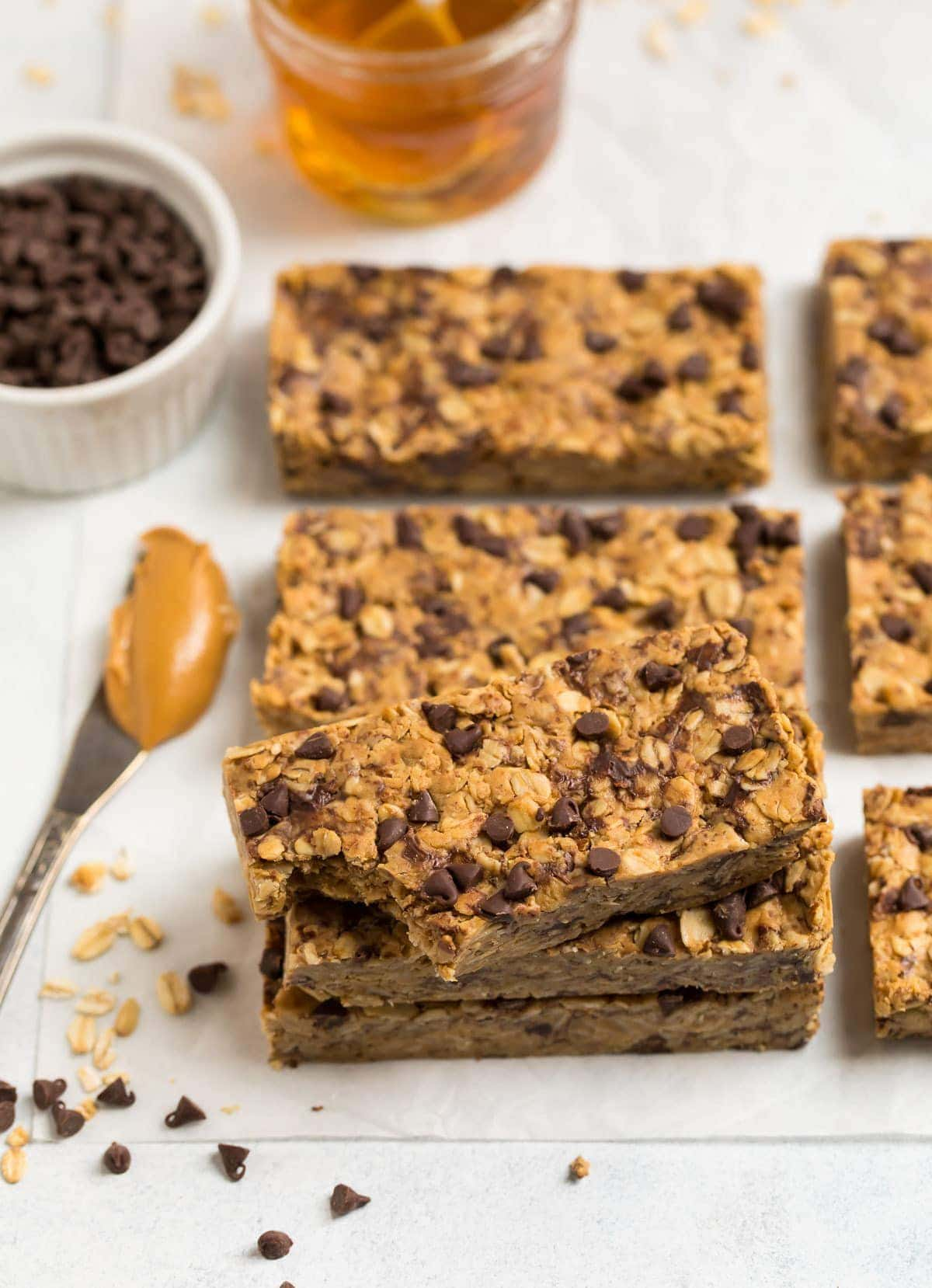 Soft and chewy homemade Peanut Butter Protein Bars with simple ingredients like oatmeal, honey, chocolate chips, and protein powder. No bake, healthy, and way better tasting than store bought!