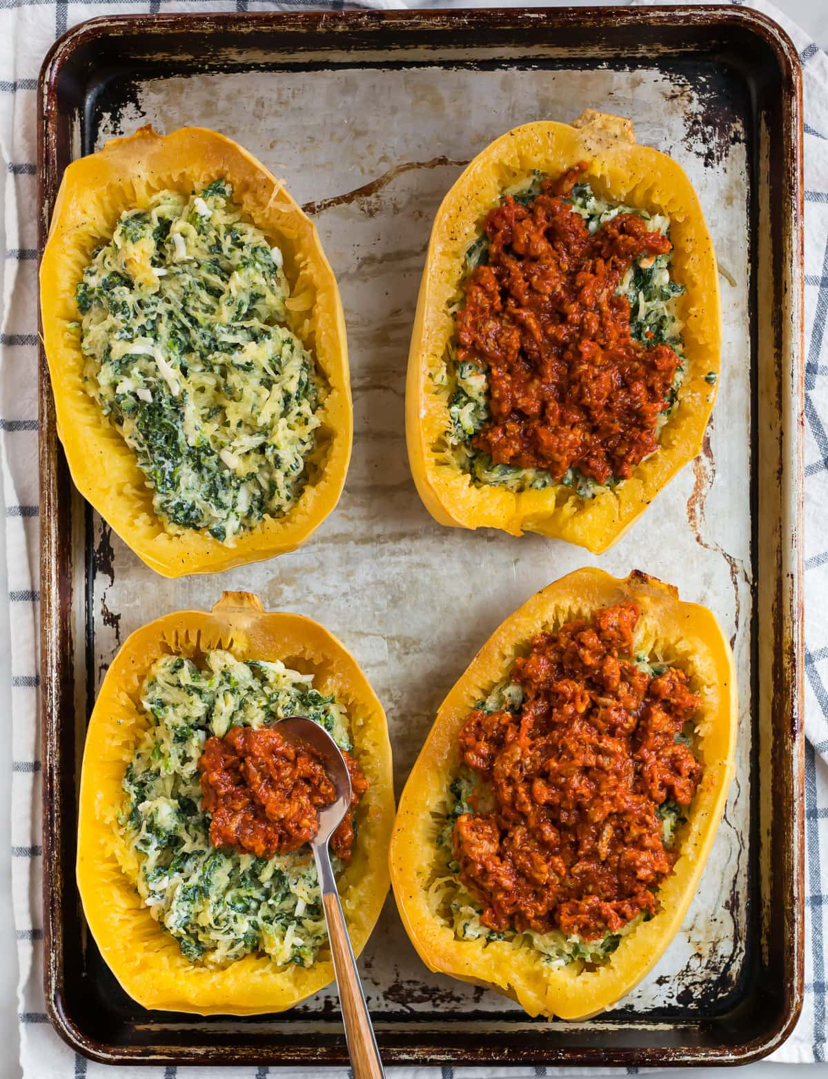 Spaghetti squash halves being made into lasagna