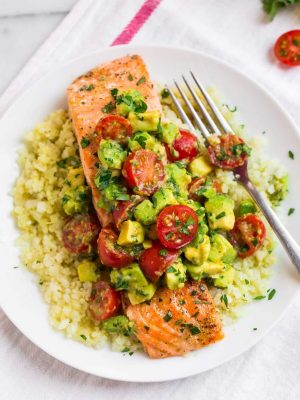 Baked Whole30 Salmon with Creamy Avocado Sauce. Tender and flakey with the most delicious cilantro lime flavors, this easy salmon recipe is perfect for quick, healthy dinners, even if you aren't following a Whole30 diet and is paleo and gluten free too!