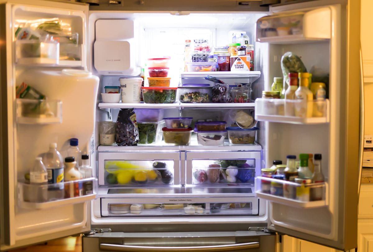 An open fridge that's full of containers