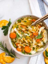 Crock pot chicken noodle soup in a white bowl