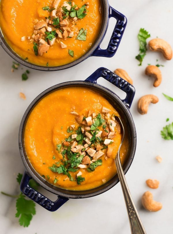 Two bowls of Instant Pot Carrot Soup with Ginger. Creamy, vegan, and delicious healthy recipe!