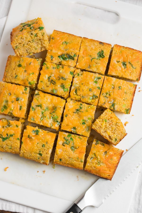 Easy Mexican Cornbread from scratch! So much better than a Jiffy mix. This cheesy stuffed Mexican cornbread recipe is moist, tender, and packed with cheese, jalapeno, and Mexican corn.