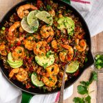 Healthy Mexican Shrimp and Rice. Easy one skillet dinner that's full of spicy Mexican flavor! Juicy shrimp, colorful veggies, whole grain brown rice, and black beans make this a true all-in-one meal.