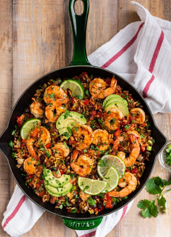 Seafood and rice in a skillet with lime