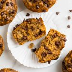 Moist healthy banana chocolate chip muffins with applesauce. Easy, vegan, and whole wheat, these simple muffins are perfect for healthy breakfasts! Clean eating and kid friendly.