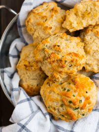 Fluffy drop biscuits in a bowl with a dish towel