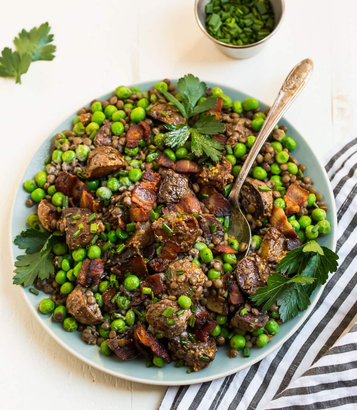 Easy Pea Salad. A delicious spring salad with bacon, potatoes, and lentils.