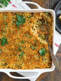 A white baking dish with broccoli rice casserole