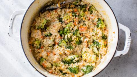 Broccoli rice casserole in a Dutch oven