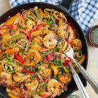 A skillet of creamy and healthy Cajun Shrimp Pasta