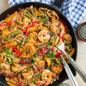A skillet of creamy and healthy Cajun Shrimp Pasta