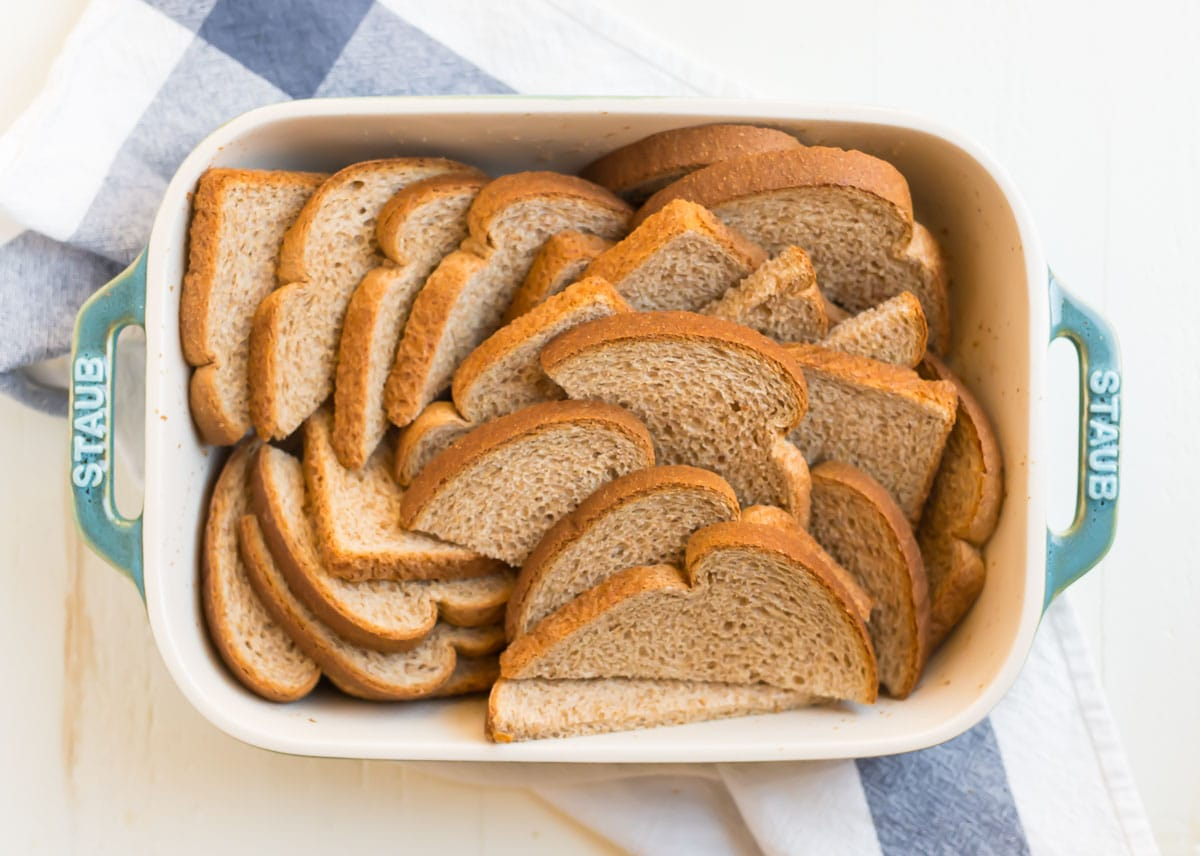 Slices of whole wheat bread fanned in a casserole dish