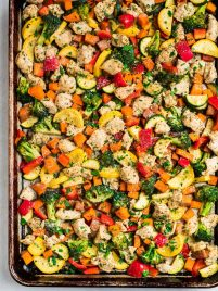 A sheet pan with chicken and rainbow vegetables