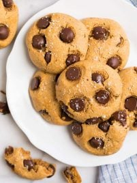 A white plate with chocolate chip almond flour cookies