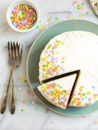 The BEST moist Coconut Flour Cake. Tender and fluffy, this richly flavored cake is easy to make and has a hint of lemon and almond. Paleo and dairy free.