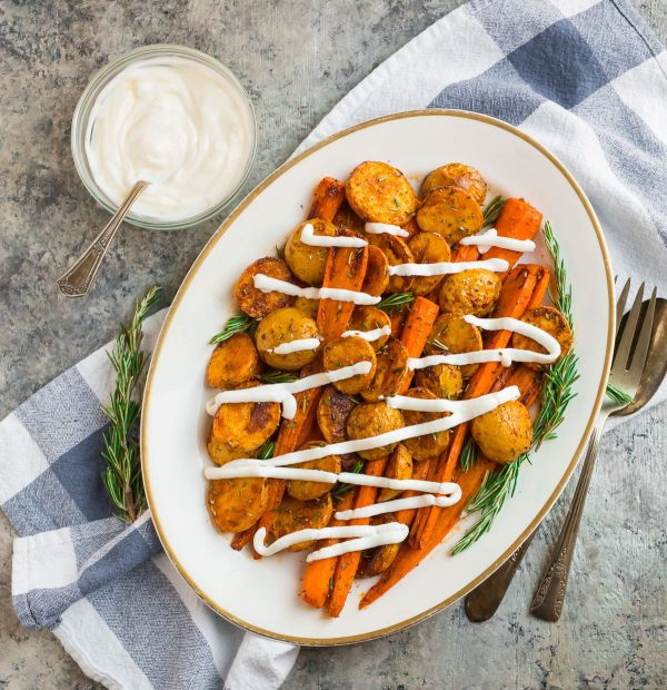 A platter of Roasted Potatoes and Carrots with Greek yogurt sauce